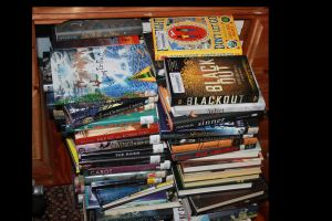 If the adage, 'he who dies with the most toys wins' includes books not read, then I'm in the running.
